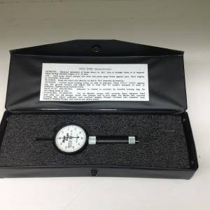 Gauge inside black carrying case